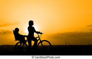Mother riding on a bicycle with her child