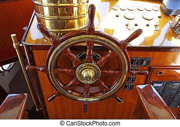 steering wheel on a luxury yacht cabin.
