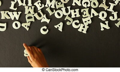 A person spelling Success - A person spelling success with...