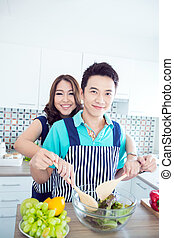 Happy couple in kitchen - Young happy couples in domestic...