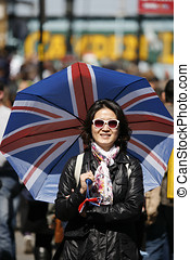 Asian woman visiting Camden Market - Smiling asian woman, in...