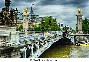 Beautiful bridge of Alexandre III in Paris at cloudy day