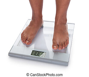 Low Section Of A Young On A Weighing Scale Against White...