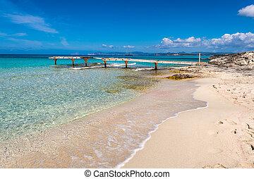Broken wooden pier Illetes beach Formentera island, Mediterranean sea, Spain