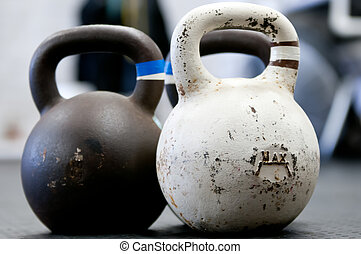 Kettlebells  - Large kettlebells on a gym floor