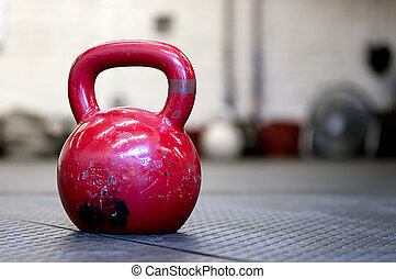 Red Kettlebell on a gym floor