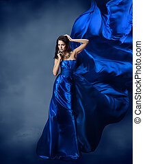 Woman in blue dress with flying silk fabric - Beautiful...