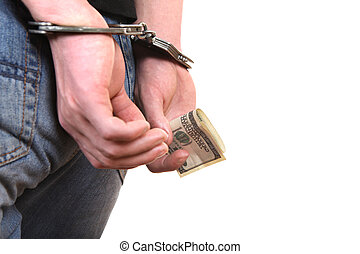 Handcuffs on Hands with Money closeup - Handcuffs on the...