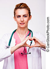 doctor showing heart sign - young doctor showing heart sign