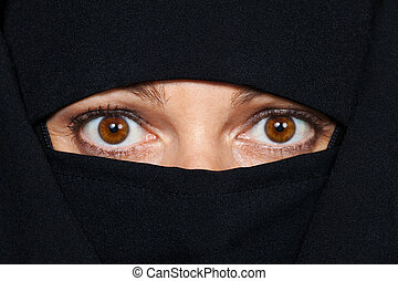 veiled woman - symbolfoto islam. muslim burqa is with...