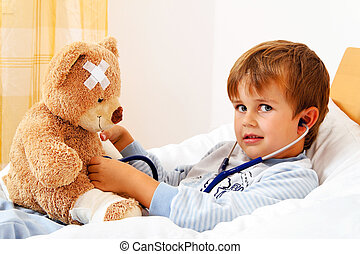 sick child examined teddy with stethoscope