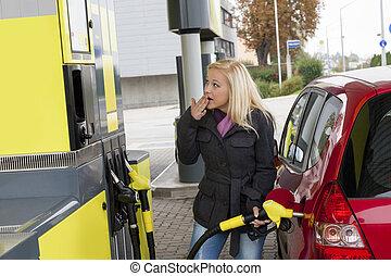 woman at refuel at petrol station