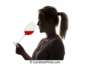 woman with red wine in a wine glass - a young woman with a...