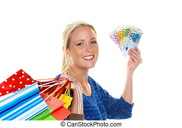 woman with shopping bags while shopping - a young woman with...