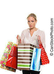 woman with colorful shopping bags - a woman with colorful...