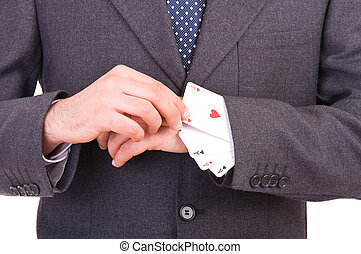 Businessman with playing cards hidden under sleeve