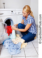 housewife with washing machine - a young housewife with...