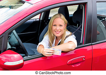 young woman with driving license - a young woman proudly...