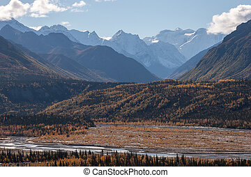 Snow Capped Peaks in Fall - Rugged snow capped peaks rise...
