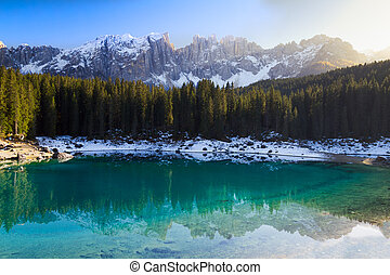 Lago di Carezza Karersee with Alps and blue skies,...