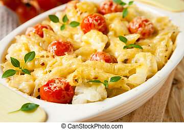 pasta baked with cheese and tomatoes, closeup