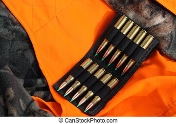 Hunting Season - Ammo on top of hunting vest and jacket.