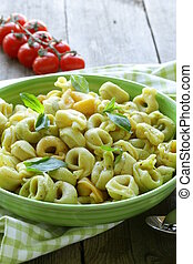 Italian tortellini with basil and olive oil