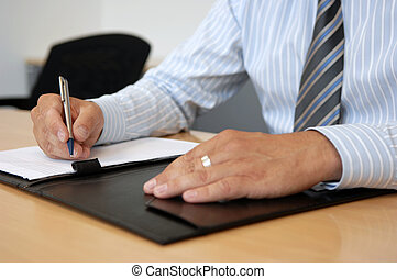 Close-Up Of Writing Hands In Business Environment, selective...