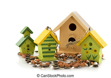 Wooden bird houses with seed for feeding