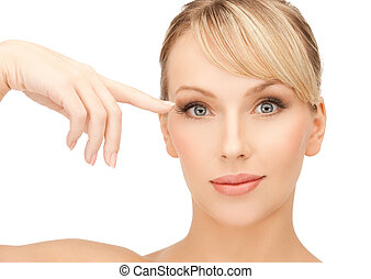 beautiful woman touching her eye area - face of beautiful...