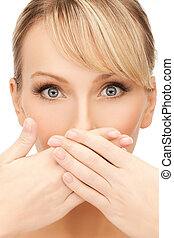 woman covering her mouth - face of beautiful woman covering...