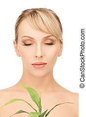 woman with green sprout - closeup picture of woman with...