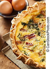 Homemade Spinach and Bacon Egg Quiche in a pie crust