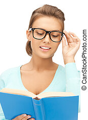 woman in glasses reading book - picture of smiling young...