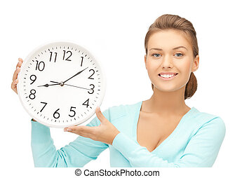 woman with wall clock - attractive woman holding wall clock...