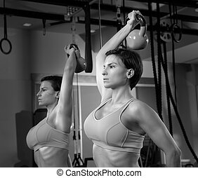 Crossfit fitness weight lifting Kettlebell woman at mirror...