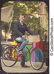 Man with bike at oudoor.