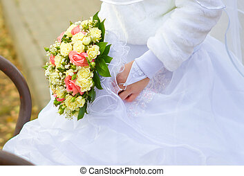 Hand with a wedding bouquet