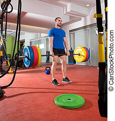 Crossfit fitness gym heavy weight lifting bar man workout
