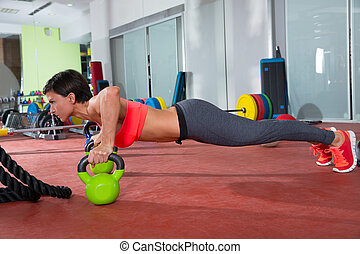 Crossfit fitness woman push ups Kettlebells pushup exercise...