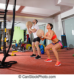 Crossfit ball fitness workout group woman and man at gym