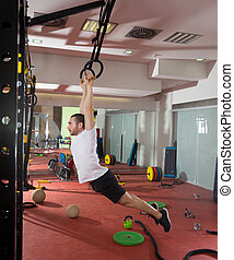 Crossfit fitness dip ring swing exercise man workout at gym