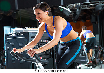 Aerobics spinning monitor trainer woman at gym at trainning...