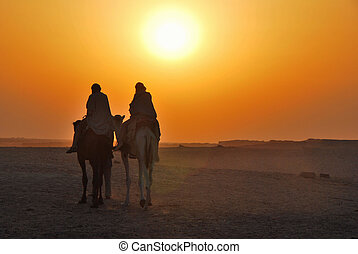 two camel rider at sunset