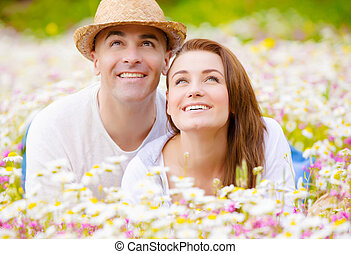 Young family on camomile glade - Beautiful young family...