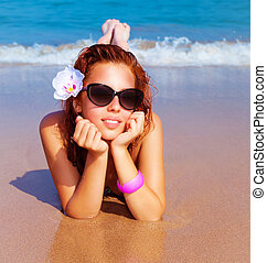 Beautiful female on the beach - Closeup portrait of...