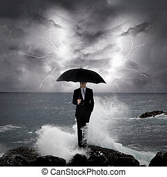 Business man under an umbrella in the sea - Business man...