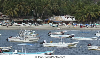timelapse of small fishing boats in the harbour in puerto escondido, mexico
