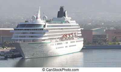 timelapse of a large cruise ship in the harbour in puerto...