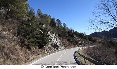 shot from a moving car with the camera clamped to the roof, pyrenees, spain